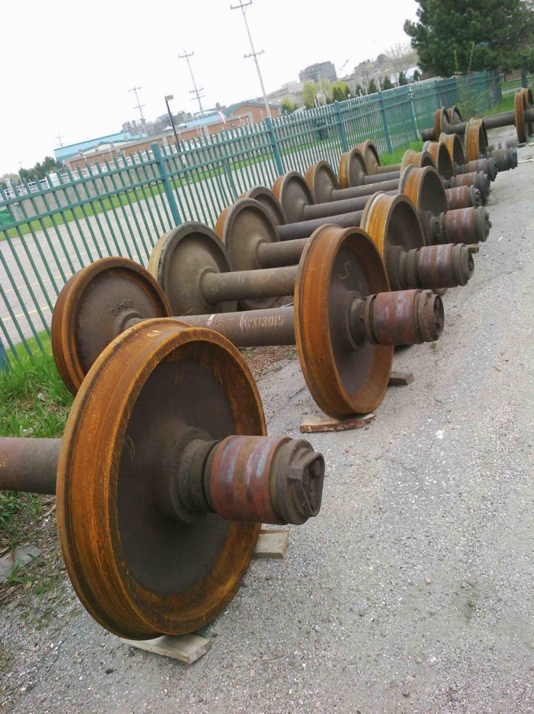 Rusty spools line the walkway